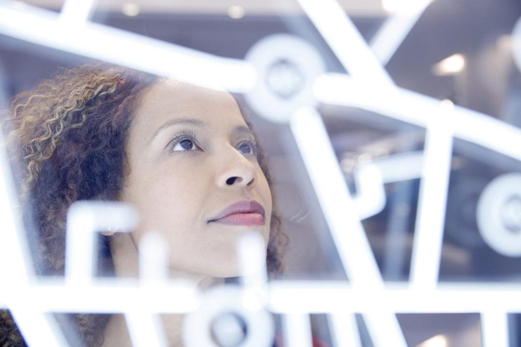 Portrait of woman operating digital interface technology