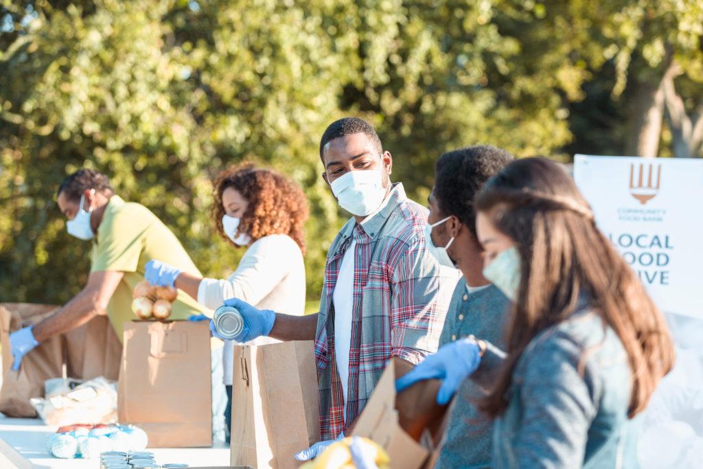 Community food bank volunteers working during COVID-19 crisis