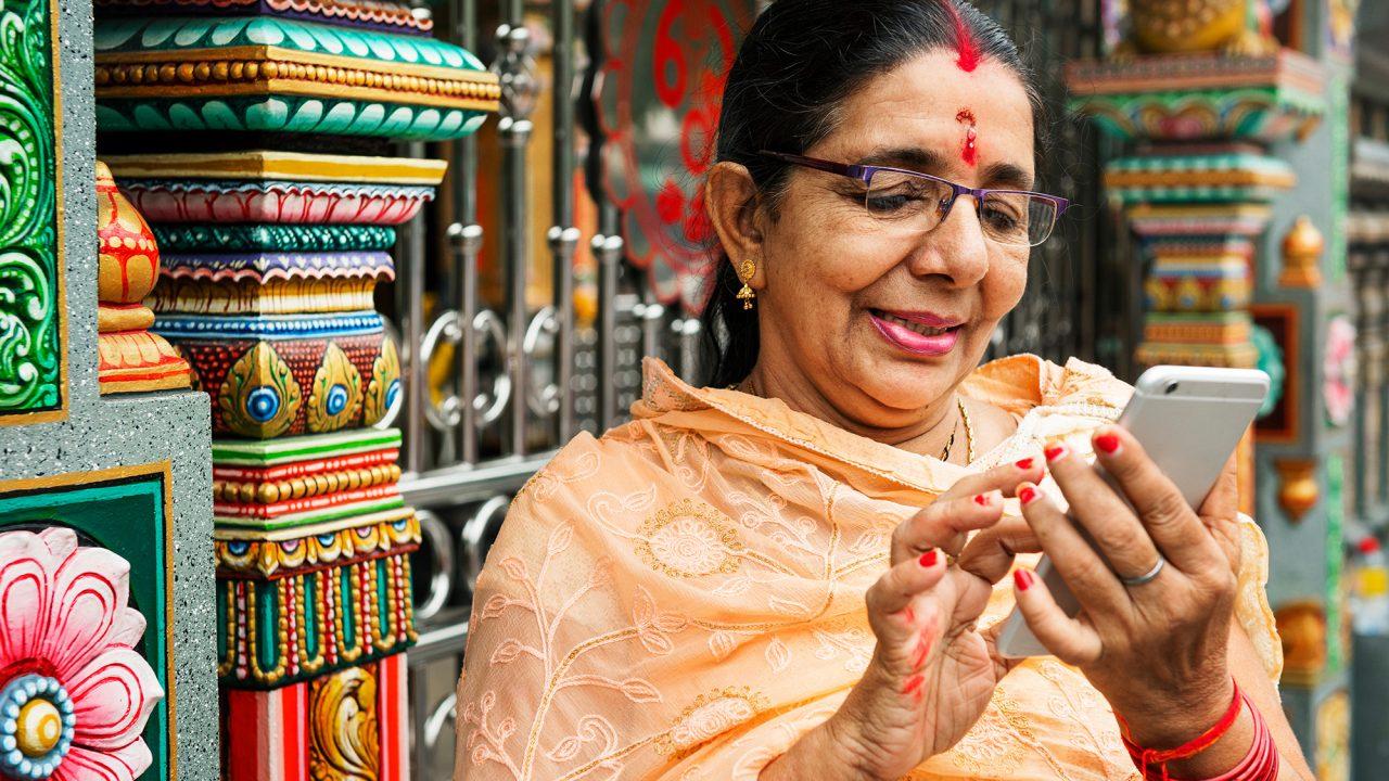 An Indian woman using a cellphone.